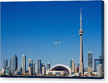 Airplane Over City Skylines, Cn Tower Canvas Print by Panoramic Images