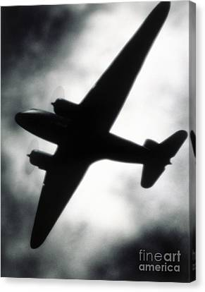 Airplane Silhouette Canvas Print by Tony Cordoza