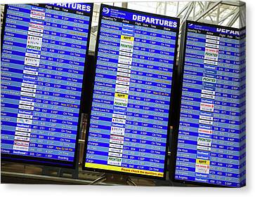 Airport Departures Board Canvas Print by Jim West