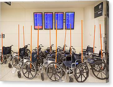 Airport Wheelchairs Canvas Print by Jim West