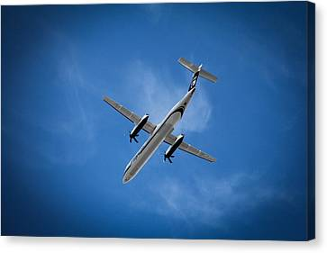 Airplanes Canvas Print featuring the photograph Alaska Airlines Turboprop by Aaron Berg