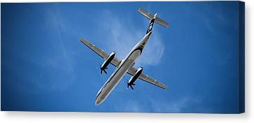 Airplanes Canvas Print featuring the photograph Alaska Airlines Turboprop Wide Version by Aaron Berg