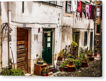 Alfama Houses Canvas Print by Paul Donohoe
