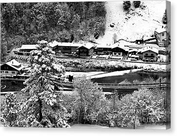 All Lined Up In Berchtesgaden Canvas Print by John Rizzuto
