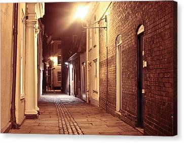 Alley At Night Canvas Print by Tom Gowanlock