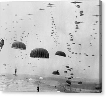 Tntar Canvas Print - Allied Aircraft Drop Paratroopers by Everett