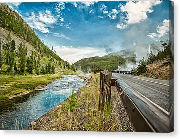Along The Volcanic Yellowstone Road Canvas Print by Andres Leon