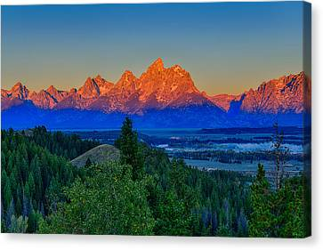 Alpenglow Across The Valley Canvas Print by Greg Norrell