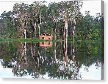 Canvas Print featuring the photograph Amazon Reflections With Abandoned House by Nareeta Martin