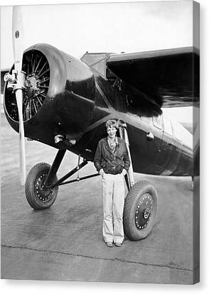 Pioneers Canvas Print - Amelia Earhart And Her Plane by Underwood Archives