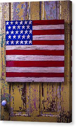 American Flag On Old Door Canvas Print by Garry Gay