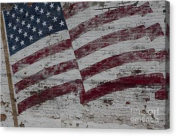 Canvas Print featuring the photograph American Flag Painted On Brick Wall by Keith Kapple