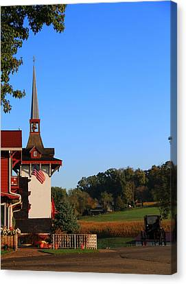 Amish Buggy And Church Canvas Print by Dan Sproul