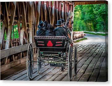 Amish Family On Covered Bridge Canvas Print by Gene Sherrill