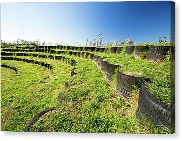 Amphitheatre Built With Used Tyres Canvas Print by Ashley Cooper