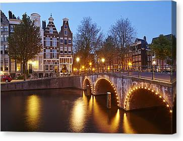 Amsterdam - Old Houses At The Keizersgracht In The Evening Canvas Print by Olaf Schulz