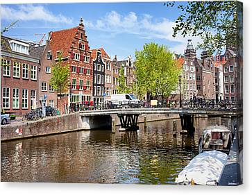 Amsterdam Canal Bridge And Houses Canvas Print by Artur Bogacki