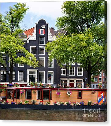 Amsterdam Canal With Houseboat Canvas Print by Jane Rix
