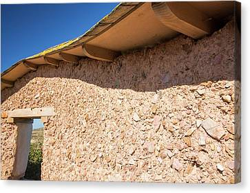 An Adobe Earth Wall Canvas Print by Ashley Cooper