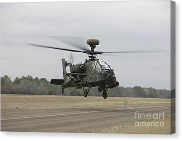 An Ah-64 Apache Helicopter In Midair Canvas Print by Terry Moore