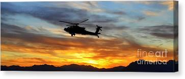 An Ah-64 Apache Canvas Print by Paul Fearn