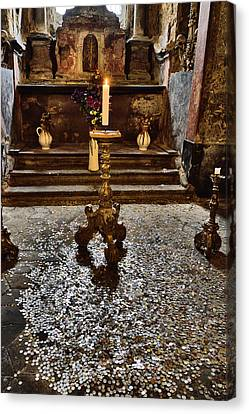An Altar. A Burning Candle. Fresh Flowers. The Coins. Canvas Print by Andy Za
