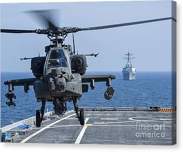 An Army Ah-64d Apache Helicopter Takes Canvas Print by Stocktrek Images