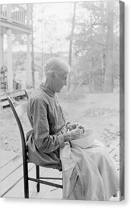 Side Porch Canvas Print - An Elder Woman Cutting Fruit On A Farm by Stocktrek Images