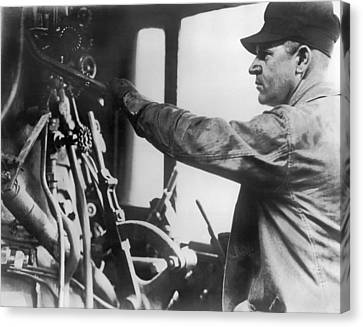 An Engineer In A Locomotive Canvas Print by Underwood Archives