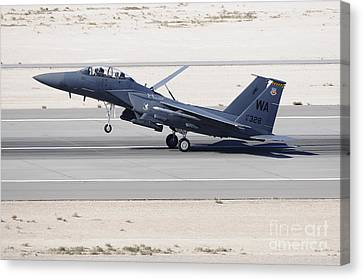 An F-15c Eagle Landing On The Runway Canvas Print by Remo Guidi