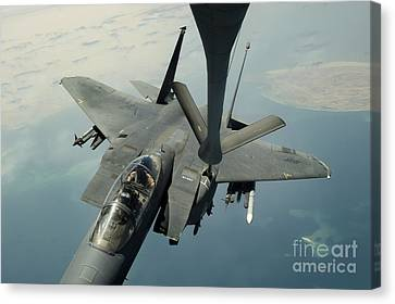 An F-15e Strike Eagle Receives Fuel Canvas Print by Stocktrek Images