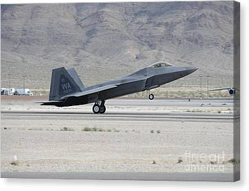 An F-22 Raptor Landing On The Runway Canvas Print by Remo Guidi