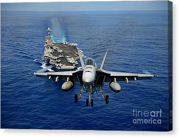 Canvas Print featuring the photograph An Fa-18 Hornet Demonstrates Air Power. by Paul Fearn