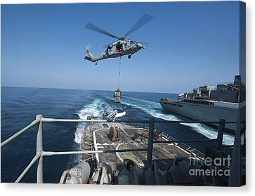An Mh-60s Sea Hawk Brings Pallets Canvas Print by Stocktrek Images