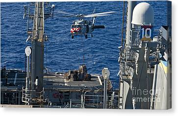 An Mh-60s Sea Hawk Delivers Supplies Canvas Print by Stocktrek Images