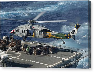 An Mh-60s Sea Hawk Helicopter Picks Canvas Print by Stocktrek Images