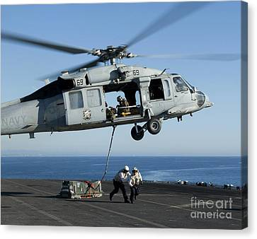 An Mh-60s Sea Hawk Helicopter Prepares Canvas Print by Stocktrek Images