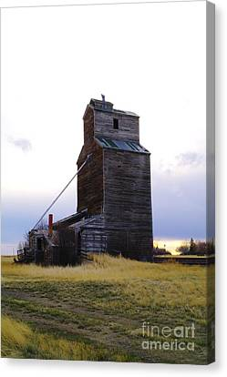 An Old Grain Elevator Off Highway Two In Montana Canvas Print by Jeff Swan