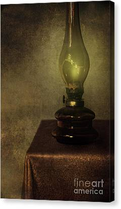 An Old Oil Lamp On The Table Canvas Print