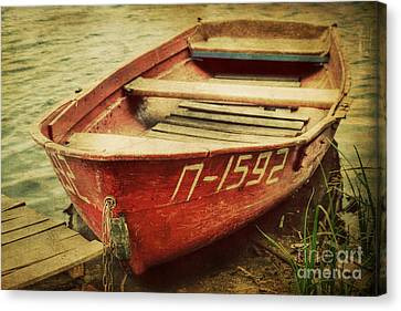 An Old Row Boat Canvas Print by Emily Kay