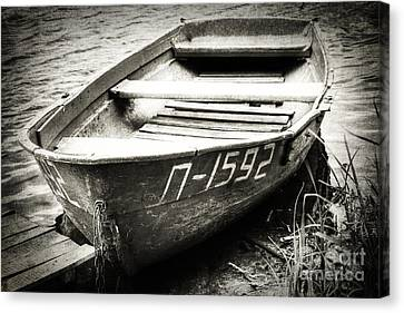 An Old Row Boat In Black And White Canvas Print by Emily Kay
