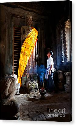 Angkor Wat Devotee Lights Incense In Buddha Temple Canvas Print