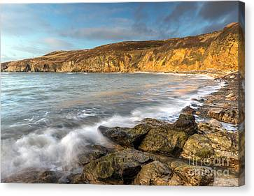 Anglesey Bay Canvas Print by Adrian Evans