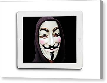 Anonymous Mask On Digital Tablet Canvas Print by Victor De Schwanberg