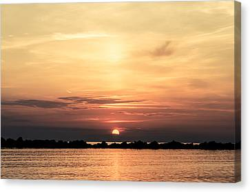 Another Earth - Sunrise On The Sea Canvas Print by Andrea Mazzocchetti