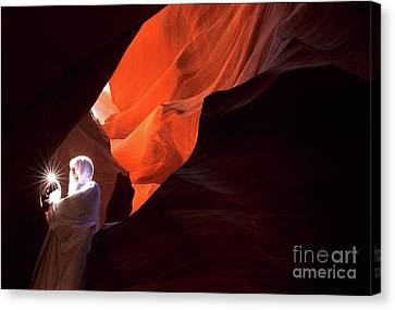 Antelope Canyon Keeper Of The Light Canvas Print by Bob Christopher