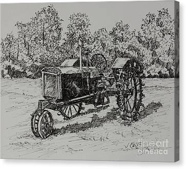 Antigue Tractor Canvas Print by Janet Felts
