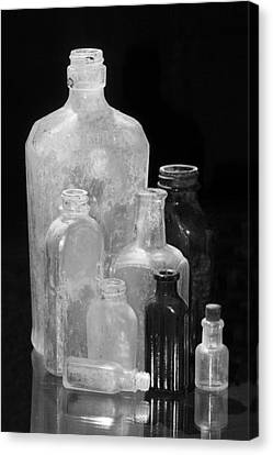 Antique Bottles 4 Black And White Canvas Print by Phyllis Denton