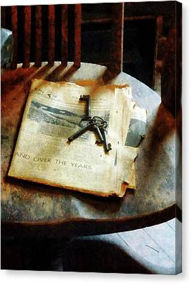 Canvas Print featuring the photograph Antique Keys On Newspaper by Susan Savad