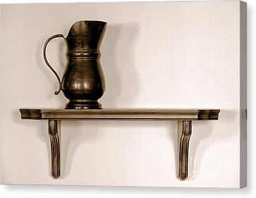 Antique Pewter Pitcher On Old Wood Shelf Canvas Print by Olivier Le Queinec